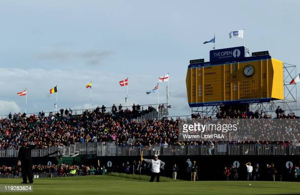 Darren Clarke of Northern Ireland acknowledges the crowd on the 18th green during the third round of The 140th Open Championship at Royal St George's...
