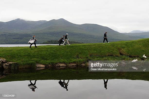 Darren Clarke of Northern Ireland and Gregory Bourdy of France walk up to the 4th tee during the Second Round of the Discover Ireland Irish Open held...