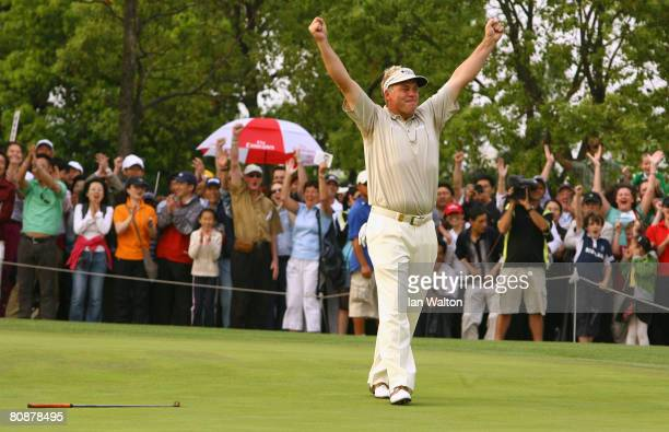Darren Clarke of Northern Ireland celebrates after his putt to win the final round of the BMW Asian Open at the Tomson Shanghai Pudong Golf Club on...