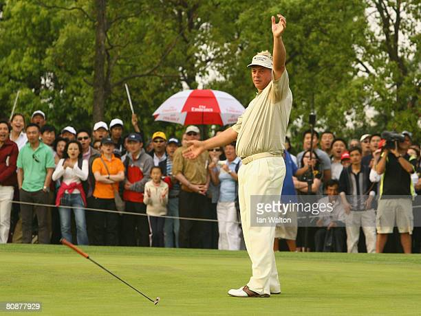 Darren Clarke of Northern Ireland celebrates after winning the final round of the BMW Asian Open at the Tomson Shanghai Pudong Golf Club on April 27,...