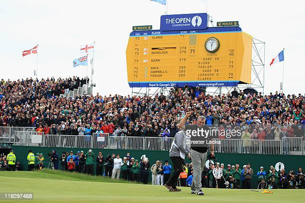 Darren Clarke of Northern Ireland celebrates victory on the 18th green during the final round of The 140th Open Championship at Royal St George's on...