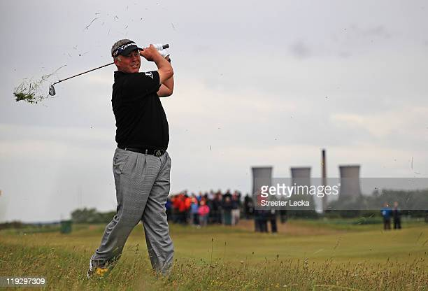 Darren Clarke of Northern Ireland hits from the rough on the 15th hole during the final round of The 140th Open Championship at Royal St George's on...