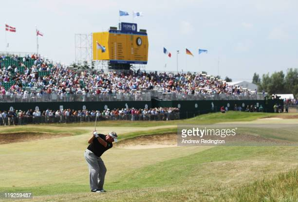 Darren Clarke of Northern Ireland hits his 2nd shot on the 18th hole during the second round of The 140th Open Championship at Royal St George's on...