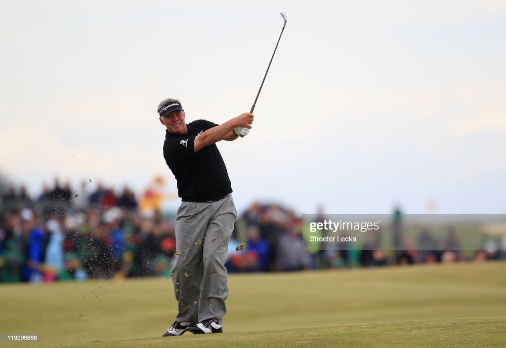 Darren Clarke of Northern Ireland hits his approach shot on the 18th hole during the final round of The 140th Open Championship at Royal St George's on July 17, 2011 in Sandwich, England.