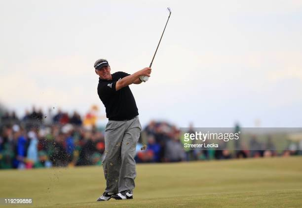 Darren Clarke of Northern Ireland hits his approach shot on the 18th hole during the final round of The 140th Open Championship at Royal St George's...