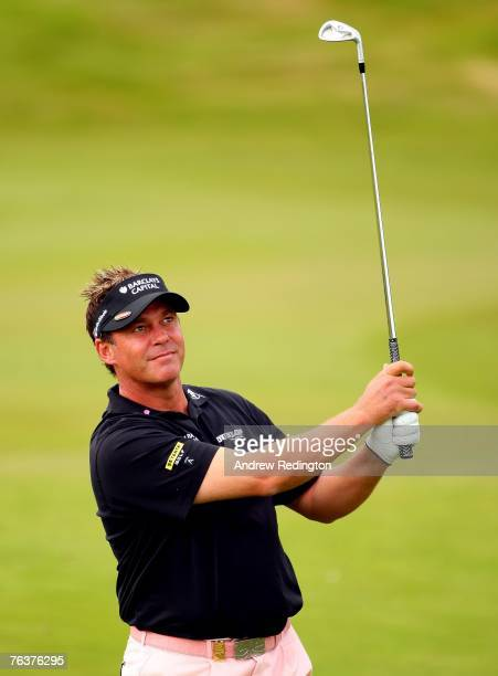 Darren Clarke of Northern Ireland hits his second shot on the 13th hole during the Pro Am prior to the start of The Johnnie Walker Championship on...