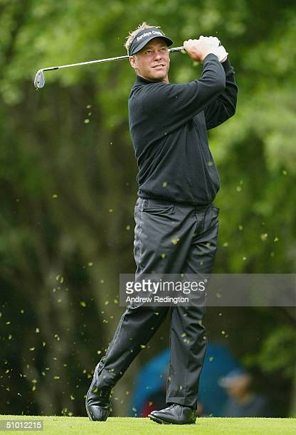 Darren Clarke of Northern Ireland hits his second shot on the ninth hole during the Proam for the Smurfit European Open on the Smurfit Course at The...