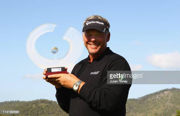 Darren Clarke of Northern Ireland holds the trophy after his victory during day four of the Iberdrola Open at Pula Golf Club on May 15 2011 in...