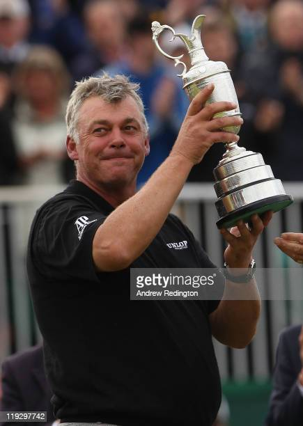 Darren Clarke of Northern Ireland lifts the Claret Jug following his victory at the end of the final round of The 140th Open Championship at Royal St...