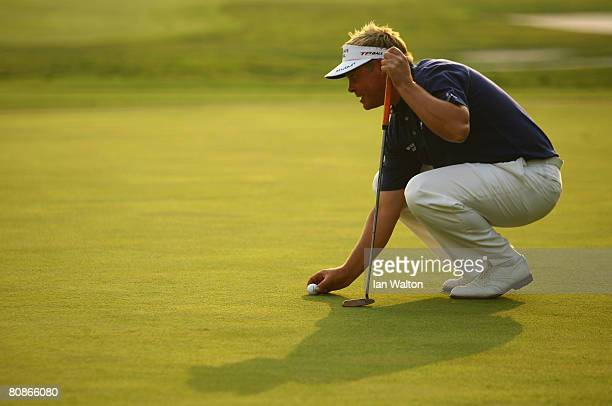 Darren Clarke of Northern Ireland lines up a put on the 18th hole during the 3rd round of the BMW Asian Open at the Tomson Shanghai Pudong Golf Club...