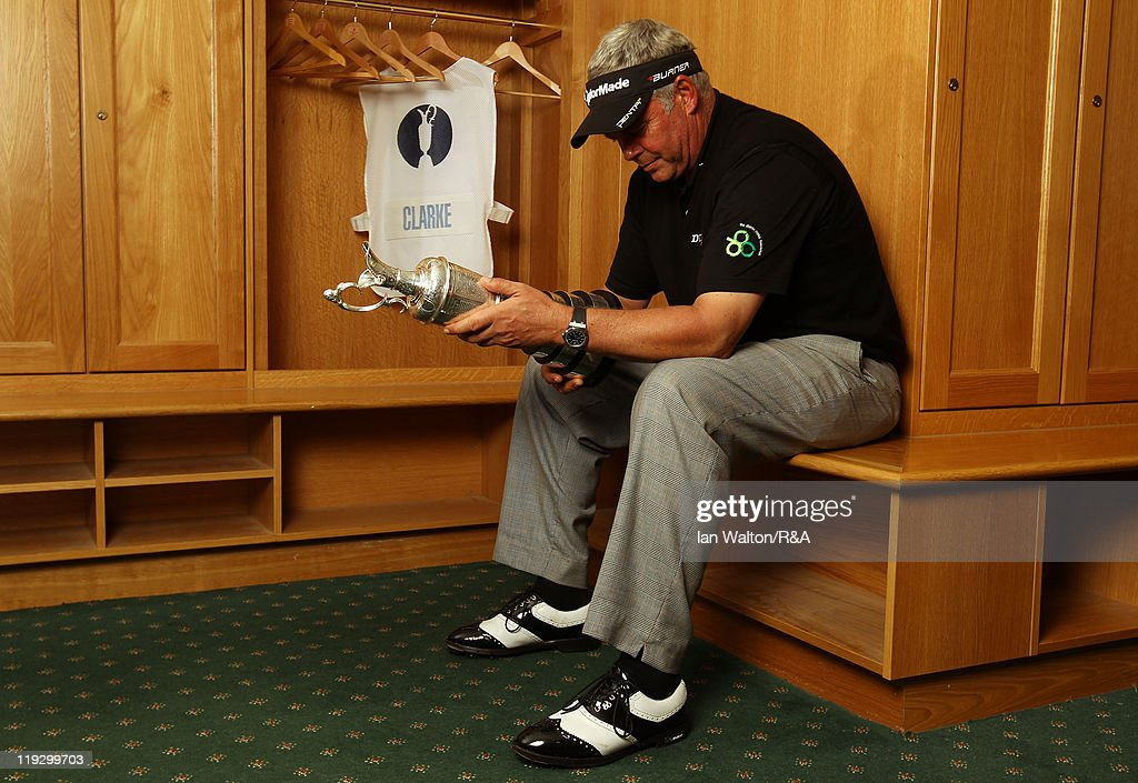 Darren Clarke of Northern Ireland looks at the Claret Jug in the locker room following his victory at the end of the final round of The 140th Open Championship at Royal St George's on July 17, 2011 in Sandwich, England.
