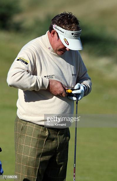Darren Clarke of Northern Ireland make adjustments to his driver during a practice round prior to the Alfred Dunhill Links Championship at Kingsbarns...