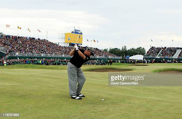 Darren Clarke of Northern Ireland makes his approach shot to the 18th green during the final round of The 140th Open Championship at Royal St...