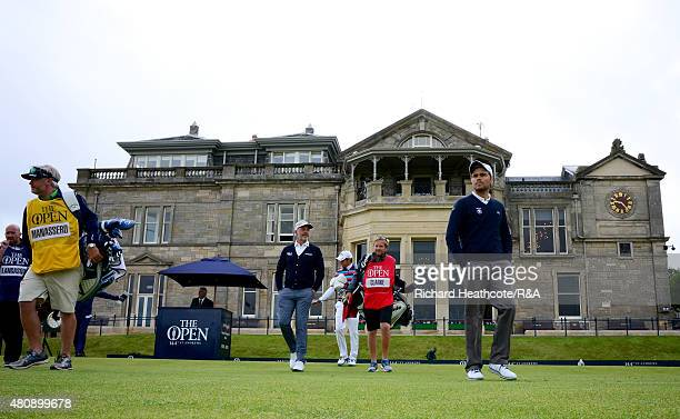 Darren Clarke of Northern Ireland Matteo Manassero of Italy and amateur Romain Langasque of France walk off the first tee with their caddies during...