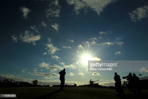 Darren Clarke of Northern Ireland plays an approach shot to the 18th green during the third round of The 140th Open Championship at Royal St George's...