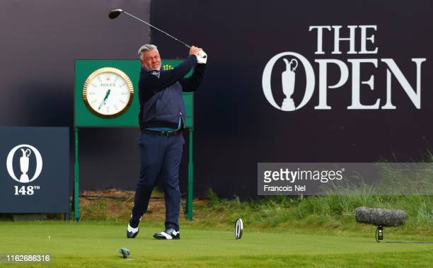 Darren Clarke of Northern Ireland plays the opening tee shot off the first tee during the first round of the 148th Open Championship held on the...