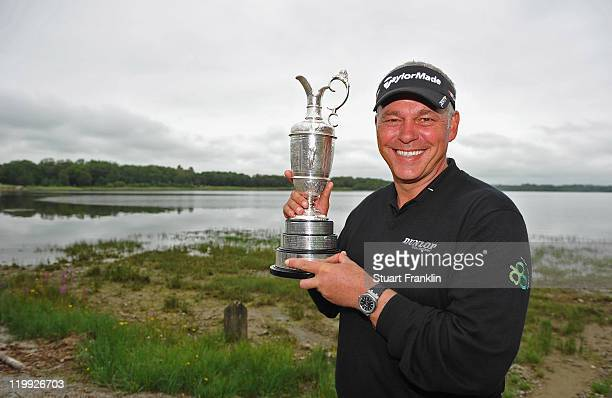 Darren Clarke of Northern Ireland poses with the Claret jug by the lake during the pro am prior to the start of the Discover Ireland Irish Open at...