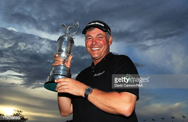 Darren Clarke of Northern Ireland poses with the Claret Jug following his victory at the end of the final round of The 140th Open Championship at...