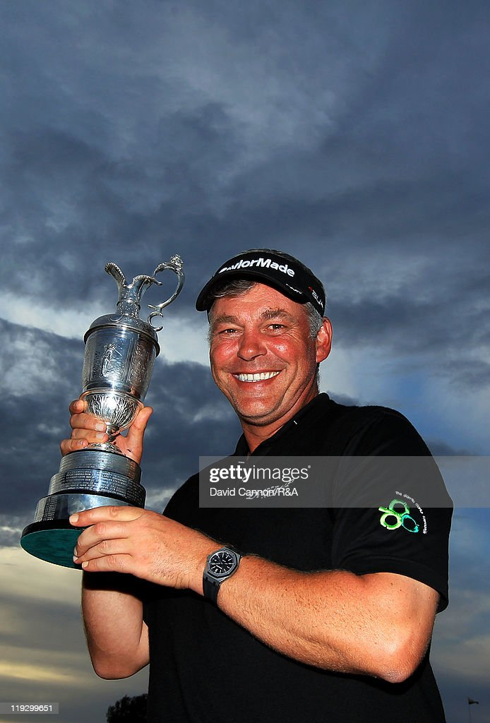 Darren Clarke of Northern Ireland poses with the Claret Jug following his victory at the end of the final round of The 140th Open Championship at Royal St George's on July 17, 2011 in Sandwich, England.