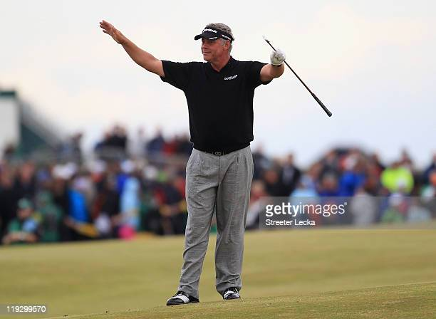 Darren Clarke of Northern Ireland quiets the crowd on the 18th hole during the final round of The 140th Open Championship at Royal St George's on...