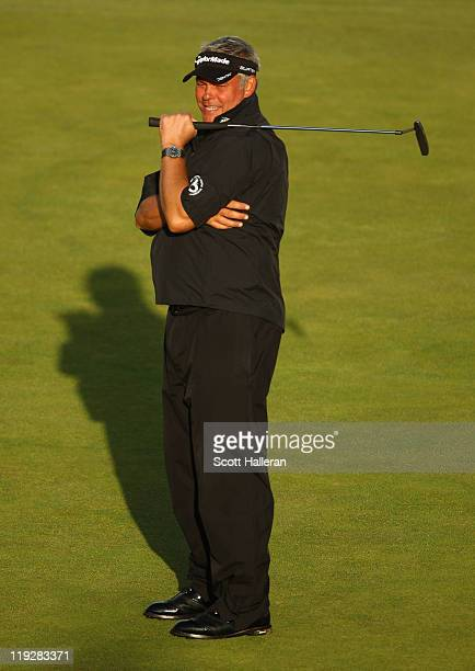 Darren Clarke of Northern Ireland reacts on the 18th green during the third round of The 140th Open Championship at Royal St George's on July 16,...