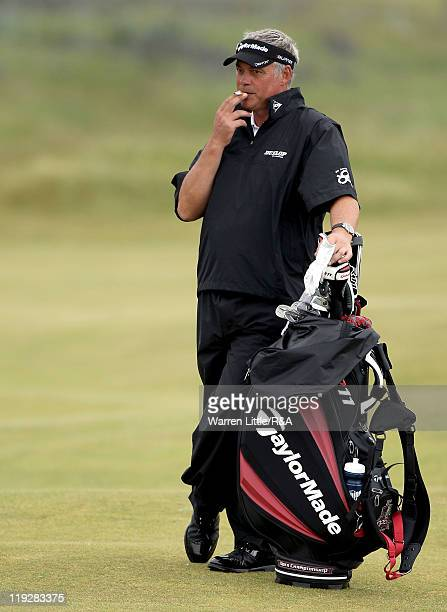 Darren Clarke of Northern Ireland smokes a cigarette on the 13th fairway during the third round of The 140th Open Championship at Royal St George's...