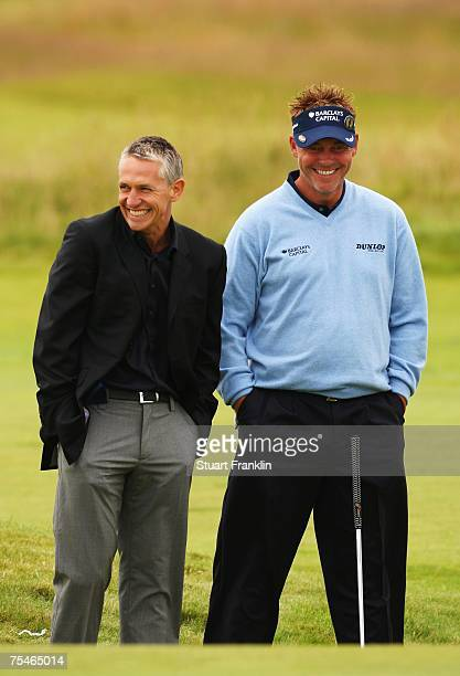 Darren Clarke of Northern Ireland talks with former England footballer and television presenter Gary Lineker while on his practice round during...