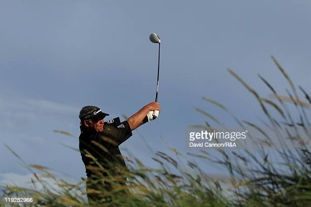 Darren Clarke of Northern Ireland tees off at the 18th hole during the third round of The 140th Open Championship at Royal St George's on July 16,...