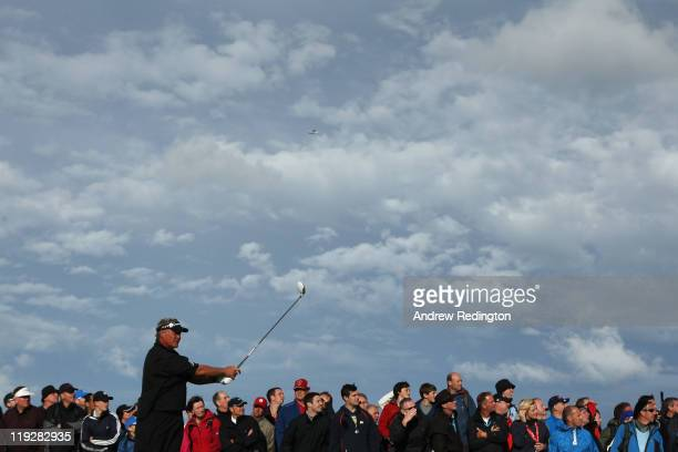 Darren Clarke of Northern Ireland tees off on the 17th hole during the third round of The 140th Open Championship at Royal St George's on July 16,...