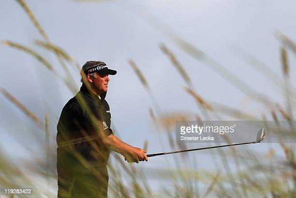 Darren Clarke of Northern Ireland tees off on the 18th hole during the third round of The 140th Open Championship at Royal St George's on July 16,...
