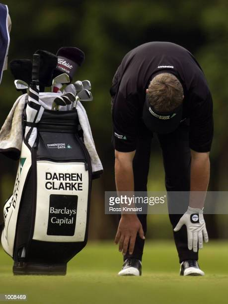 Darren Clarke of Northern Ireland touches his toes on the par four 4th hole during the second round of The Barclays Scottish Open held at the Loch...