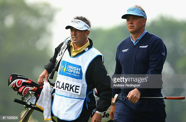 Darren Clarke of Northern Ireland walks with his caddie Phil Morbey on the 13th hole during the second round of the Irish Open on May 16 2008 at the...
