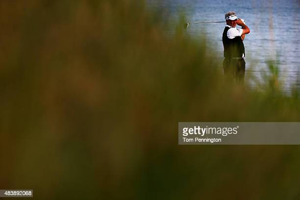 Darren Clarke of Northern Ireland watches his tee shot on the 18th hole during the first round of the 2015 PGA Championship at Whistling Straits on...