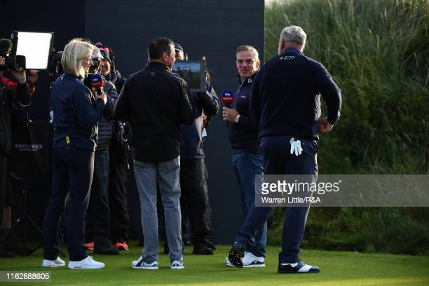 Darren Clarke of the Northern Ireland acknowledges Paul McGinley and Sky Sports Presenter Sarah Stirk following his first tee shot during the first...