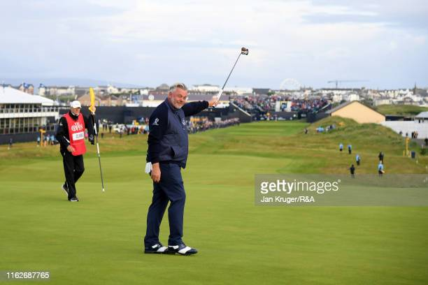 Darren Clarke of the Northern Ireland acknowledges the crowd as he scores a birdie on the first hole during the first round of the 148th Open...