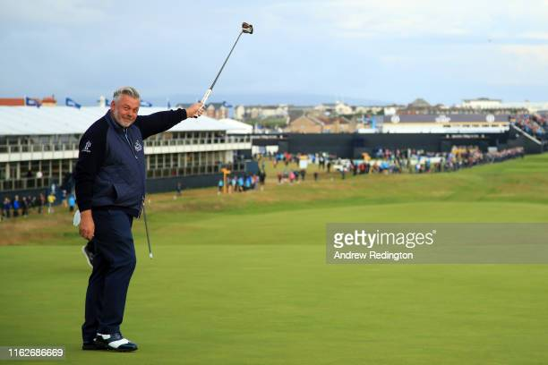 Darren Clarke of the Northern Ireland celebrates his birdie on the first green during the first round of the 148th Open Championship held on the...