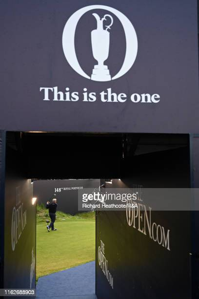 Darren Clarke of the Northern Ireland hits the opening tee shot of the championship on the first hole during the first round of the 148th Open...