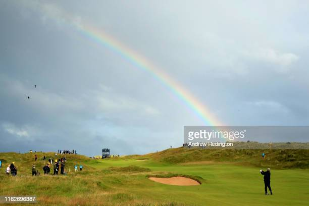 Darren Clarke of the Northern Ireland plays his second shot on the seventh hole during the first round of the 148th Open Championship held on the...