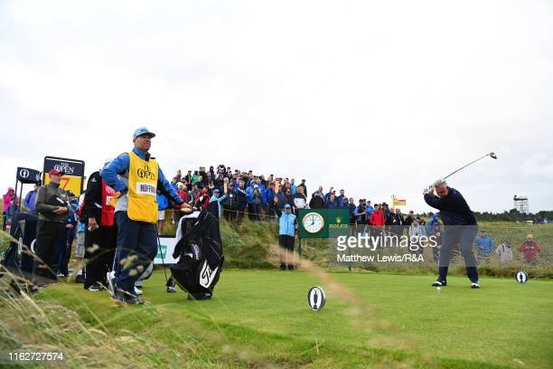 Darren Clarke of the Northern Ireland plays his shot from the seventh tee during the first round of the 148th Open Championship held on the Dunluce...