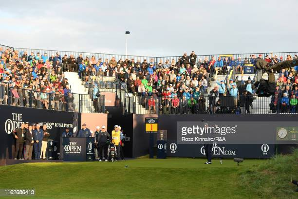 Darren Clarke of the Northern Ireland plays the opening tee shot on the first tee during the first round of the 148th Open Championship held on the...