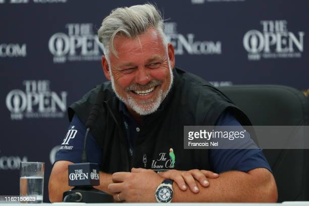 Darren Clarke of the Northern Ireland speaks to the media during a practice round prior to the 148th Open Championship held on the Dunluce Links at...