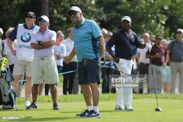 Darren Clarke oif Northern Ireland and Ian Botham react during the Pro Am for the BMW PGA Championship at Wentworth on May 23, 2018 in Virginia...