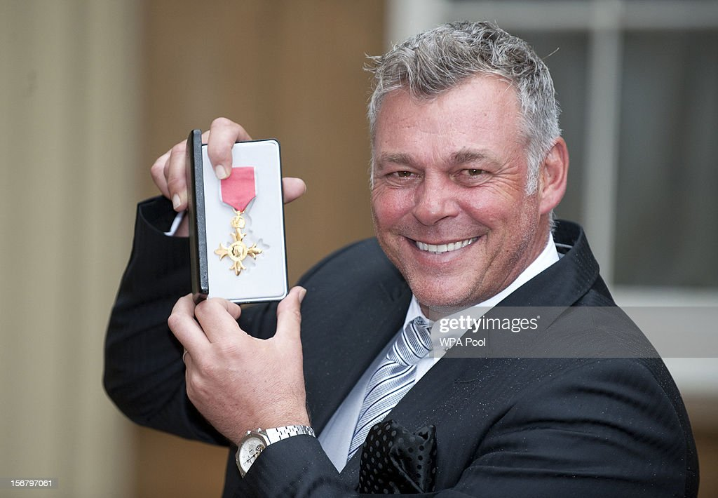 Darren Clarke poses after being awarded an OBE at Buckingham Palace for services to Golf , at Buckingham Palace on November 21, 2012 in London, England.