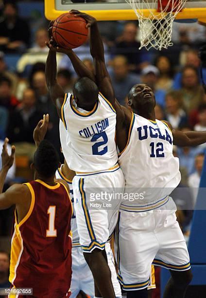 Darren Collison and Alfred Aboya of UCLA battle for rebound during 6645 victory over USC in Pacific10 Conference basketball game at Pauley Pavillion...