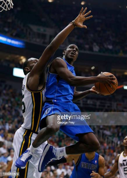 Darren Collison of Dallas Mavericks attempts a shot past Al Jefferson of the Utah Jazz during the first half of an NBA game October 31 2012 at...