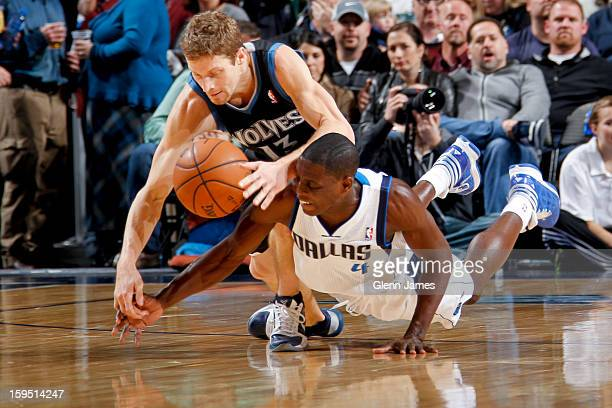 Darren Collison of the Dallas Mavericks battles for a loose ball against Luke Ridnour of the Minnesota Timberwolves on January 14 2013 at the...