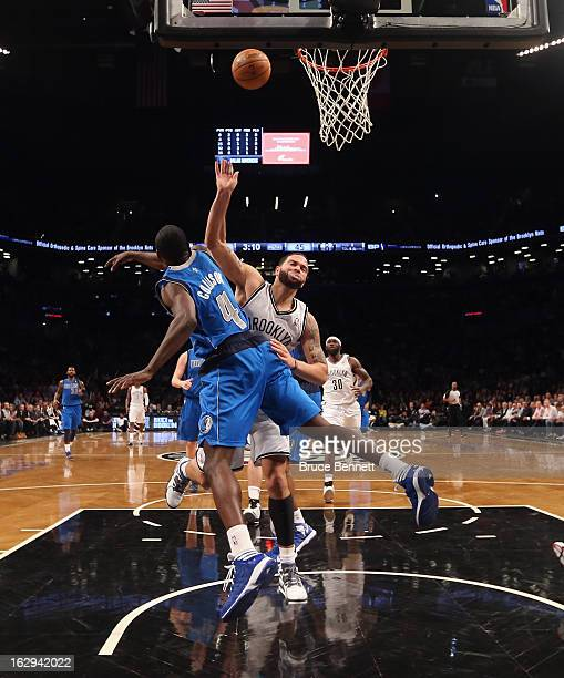 Darren Collison of the Dallas Mavericks blocks Deron Williams of the Brooklyn Nets in the second half at the Barclays Center on March 1 2013 in New...