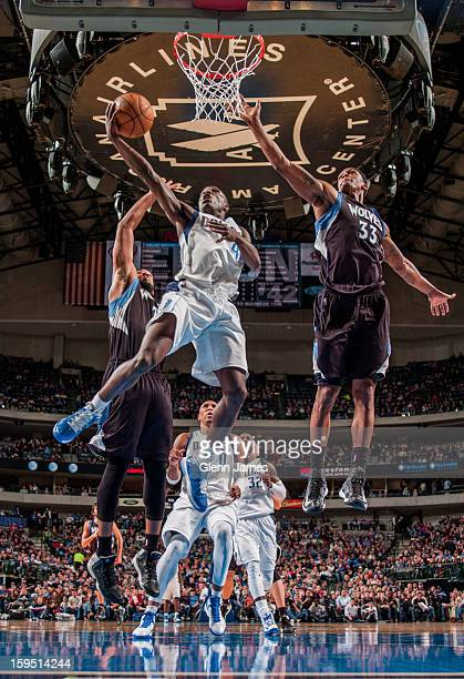 Darren Collison of the Dallas Mavericks shoots a layup against Dante Cunningham and Derrick Williams of the Minnesota Timberwolves on January 14 2013...