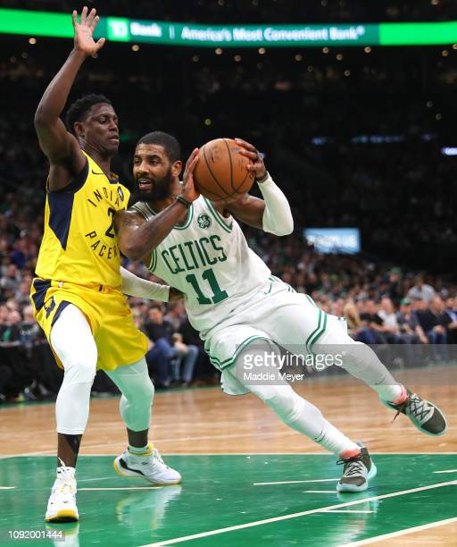 Darren Collison of the Indiana Pacers defends Kyrie Irving of the Boston Celtics during the second half of the game at TD Garden on January 09 2019...
