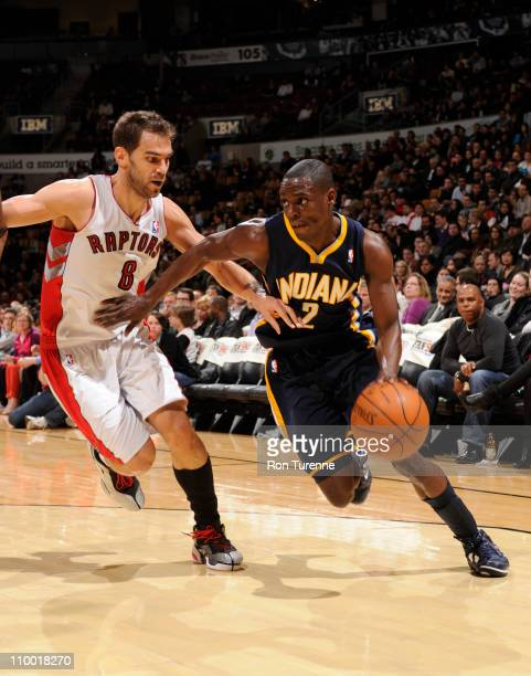 Darren Collison of the Indiana Pacers drives to the basket against Jose Calderon of the Toronto Raptors on March 11 2011 at the Air Canada Centre in...